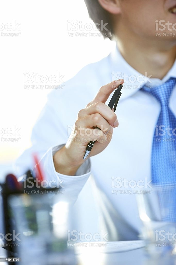 Pen in hand of male executive royalty-free stock photo