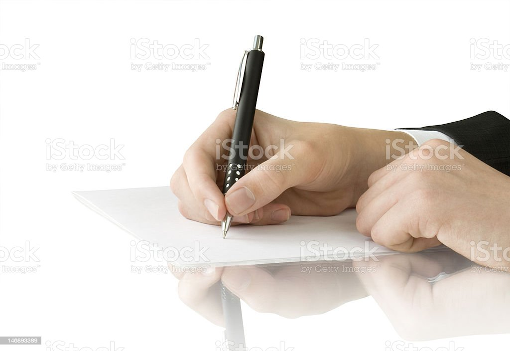 pen in hand writing on the white page royalty-free stock photo