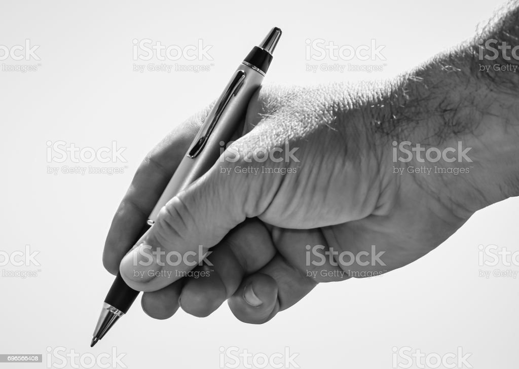 Pen in the hand stock photo