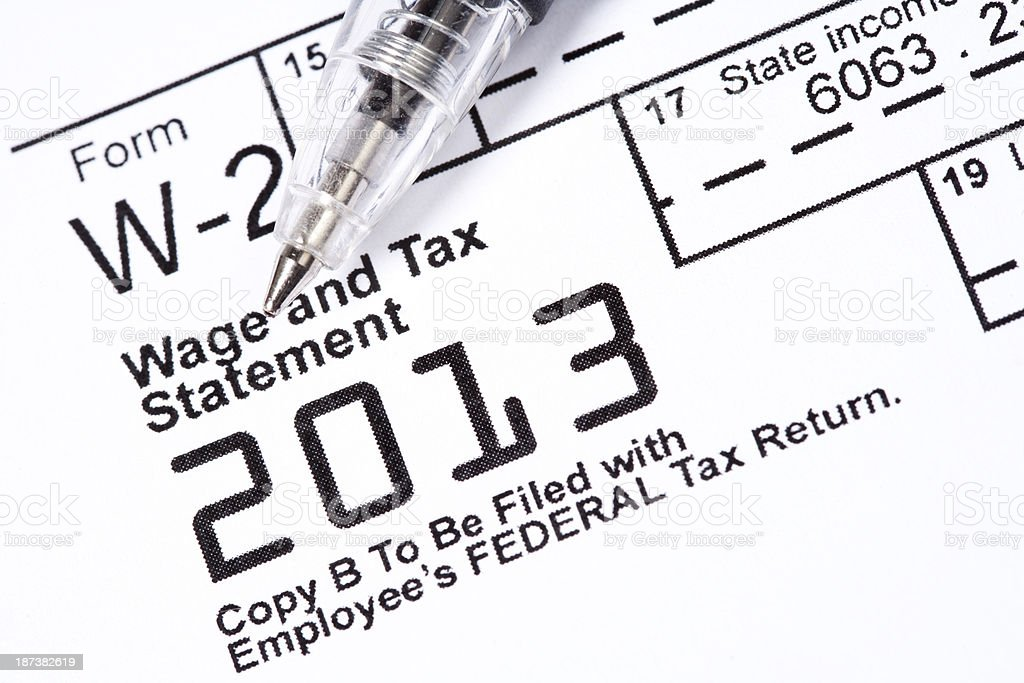 A pen left on top of a wage and tax statement royalty-free stock photo