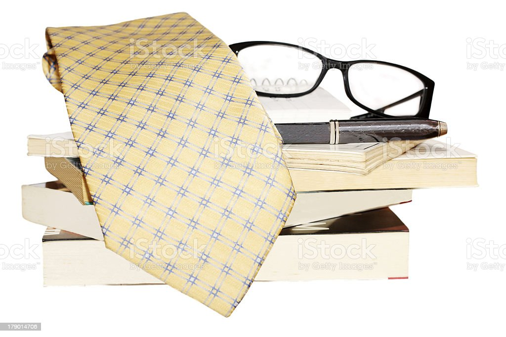 Pen, lens, pile of books and tie royalty-free stock photo