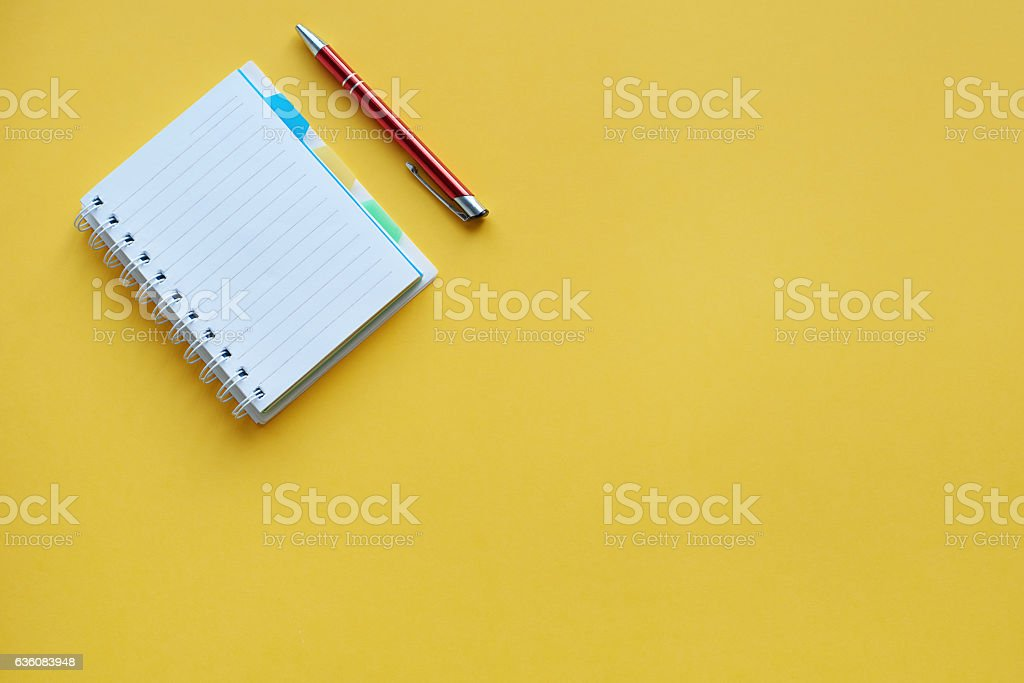 Pen lying next to open the notebook stock photo