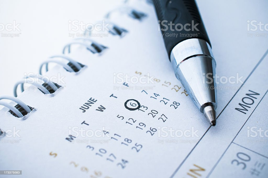 pen marked day on the calendar. stock photo