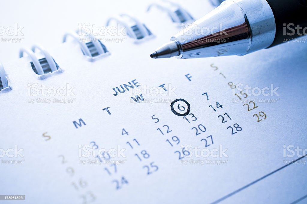 pen marked day on the calendar. royalty-free stock photo