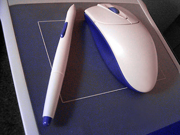 Pen & Mouse Pad stock photo