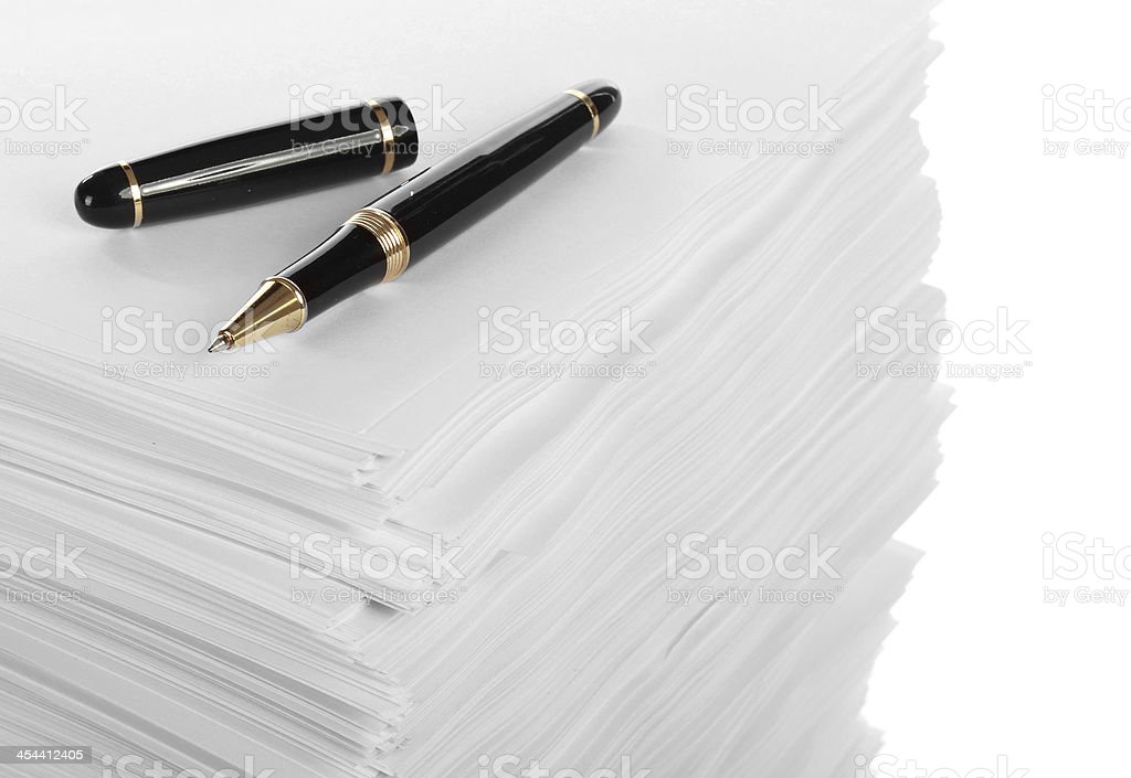 Pen near stack of paper royalty-free stock photo