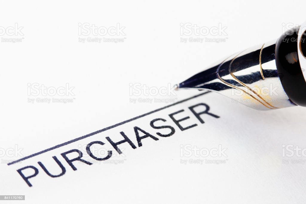Pen nib about to sign as 'purchaser' on printed form stock photo