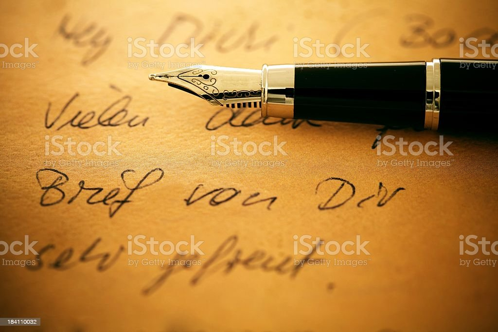pen on a old letter royalty-free stock photo