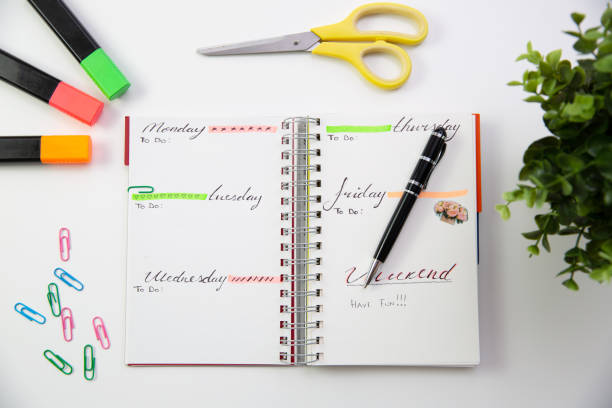 pen on a self made planner. modern office desk. working, writing concept - proiettile foto e immagini stock