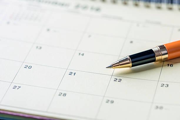 Pen on calendar stock photo