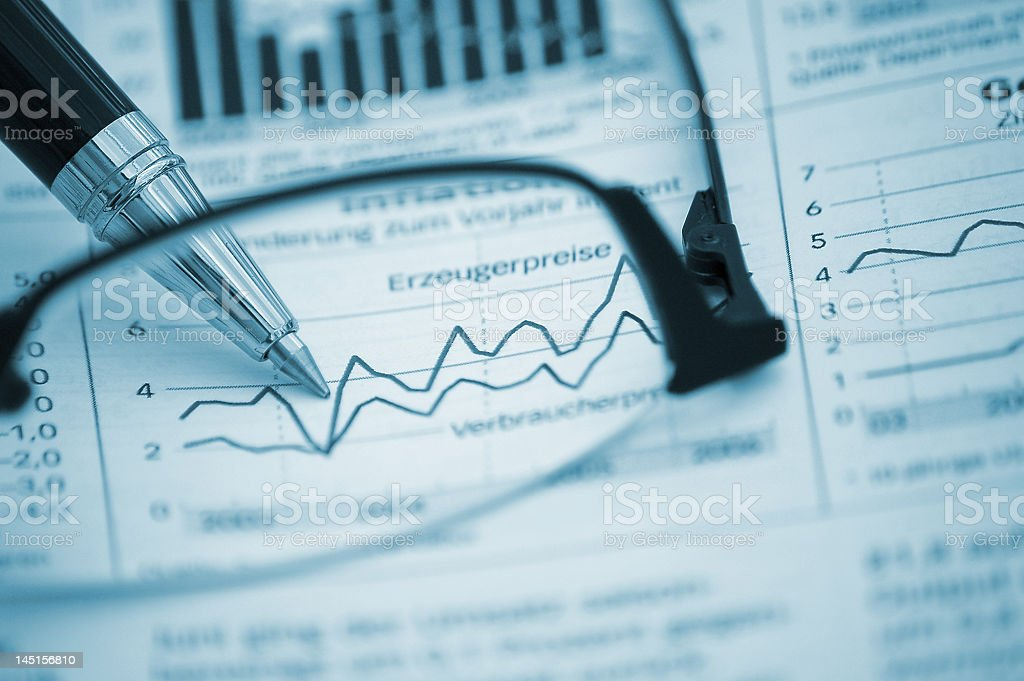 Pen on financial report royalty-free stock photo