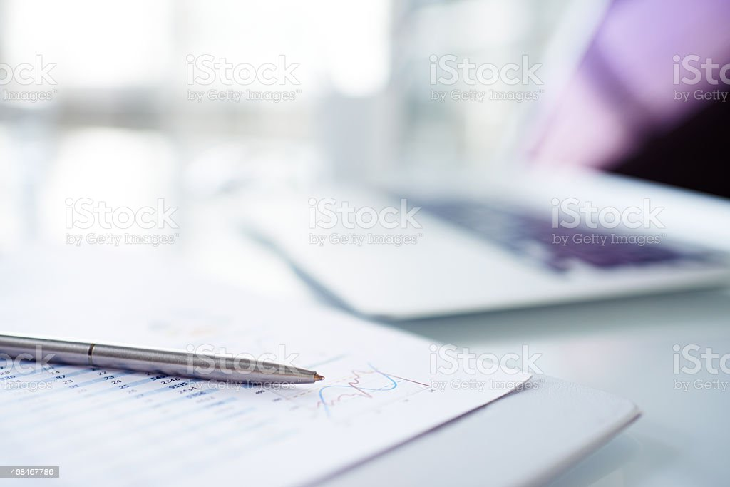 Pen on financial report stock photo