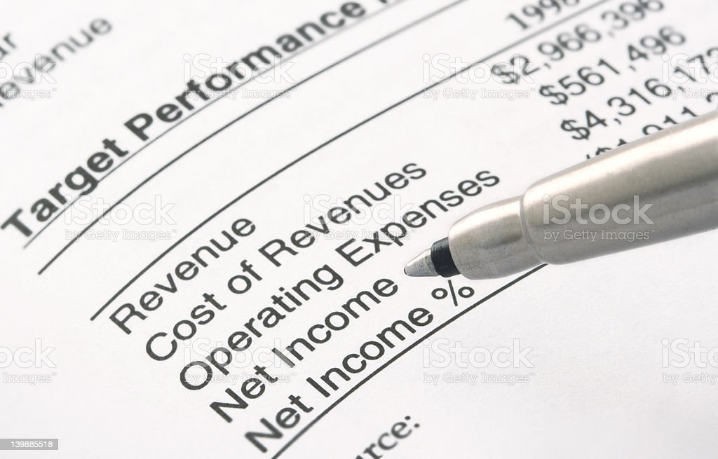 Pen on Financial Statement stock photo