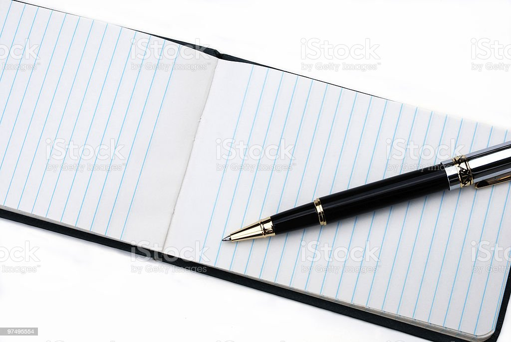 Pen on memo pad royalty-free stock photo