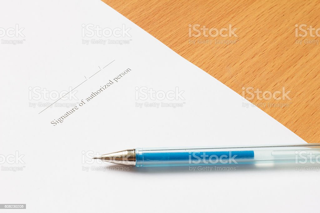 Pen on paper with Signature of authorized person wording stock photo
