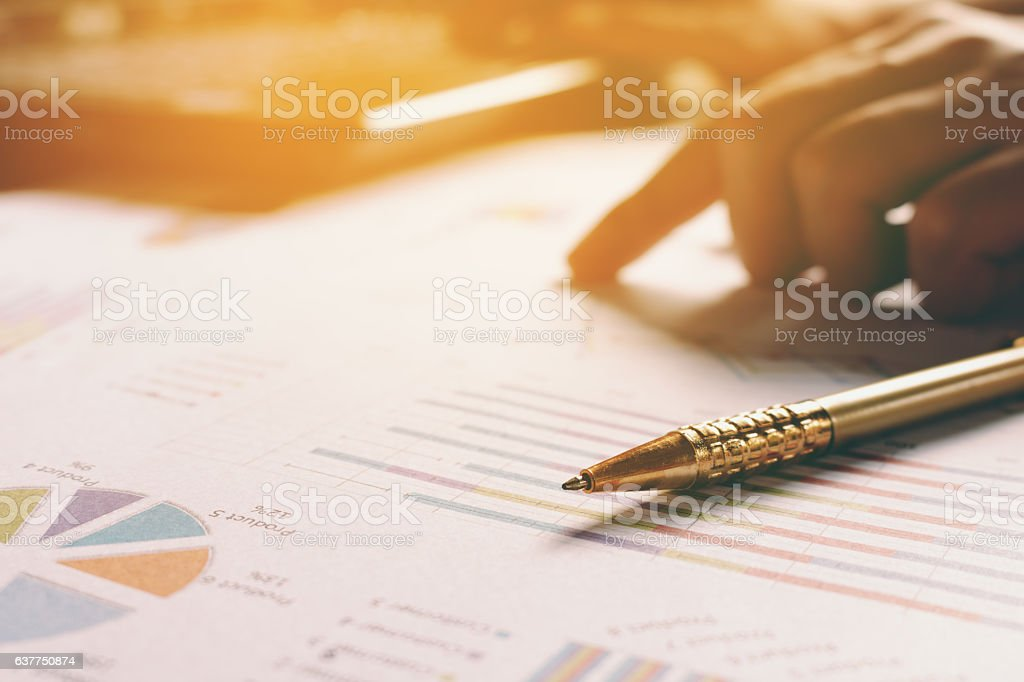 Pen on paperwork with hand man working at home office stock photo