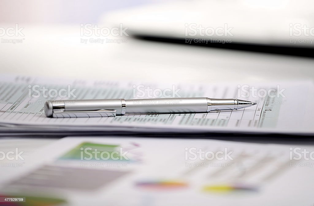 Pen on signed IRS income tax form and financial data stock photo