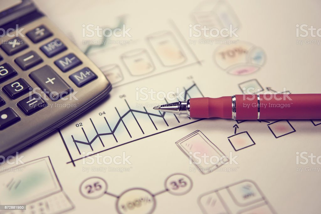Pen on sketches financial chart and graph, accounting background stock photo