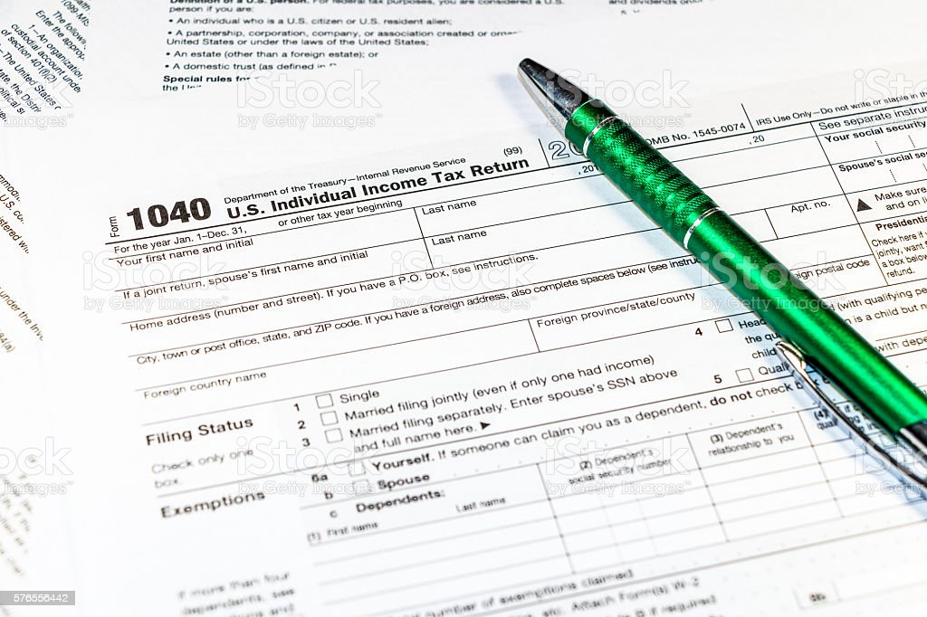 Pen on tax form 1040 stock photo