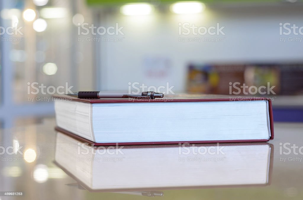 Pen on the big book. royalty-free stock photo