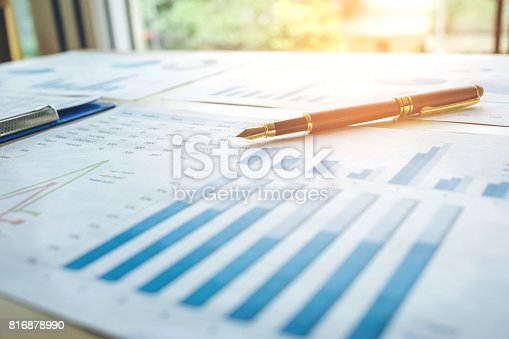 864278180istockphoto Pen  on the business paper. Report chart 816878990