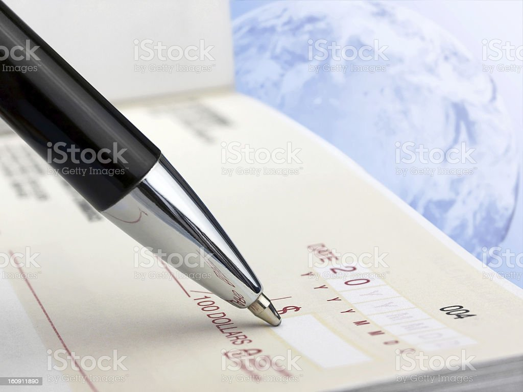 Pen on the Check royalty-free stock photo