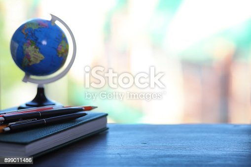 istock A pen on the desk and a small globe 899011486