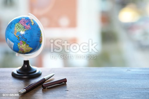 istock A pen on the desk and a small globe 925168088