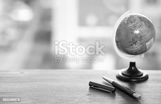 istock A pen on the desk with small globe 865596676