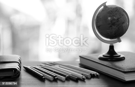 istock A pen on the desk with small globe 915066794