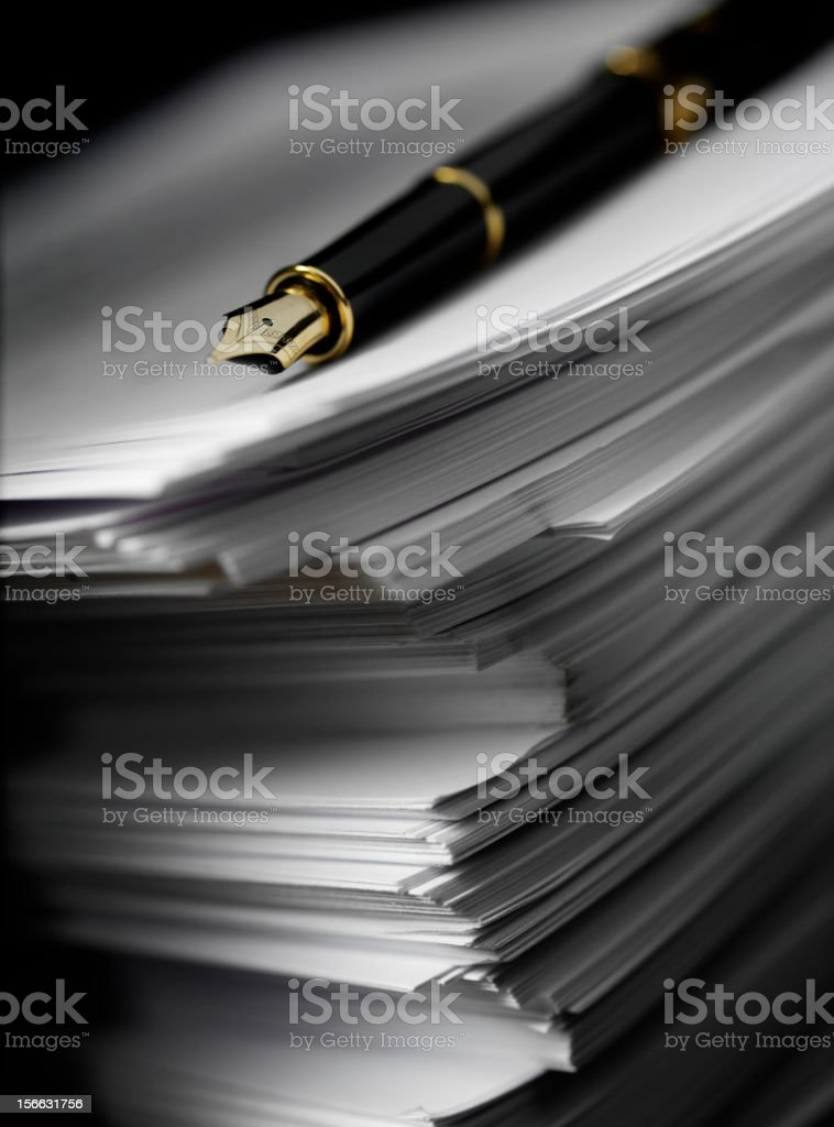Pen on the Edge of Paper royalty-free stock photo