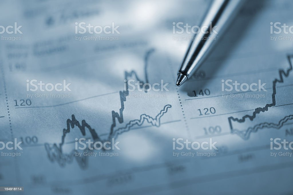A pen on the financial section of the newspaper stock photo