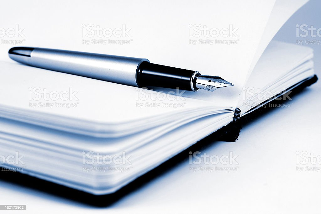 Pen on the notebook royalty-free stock photo