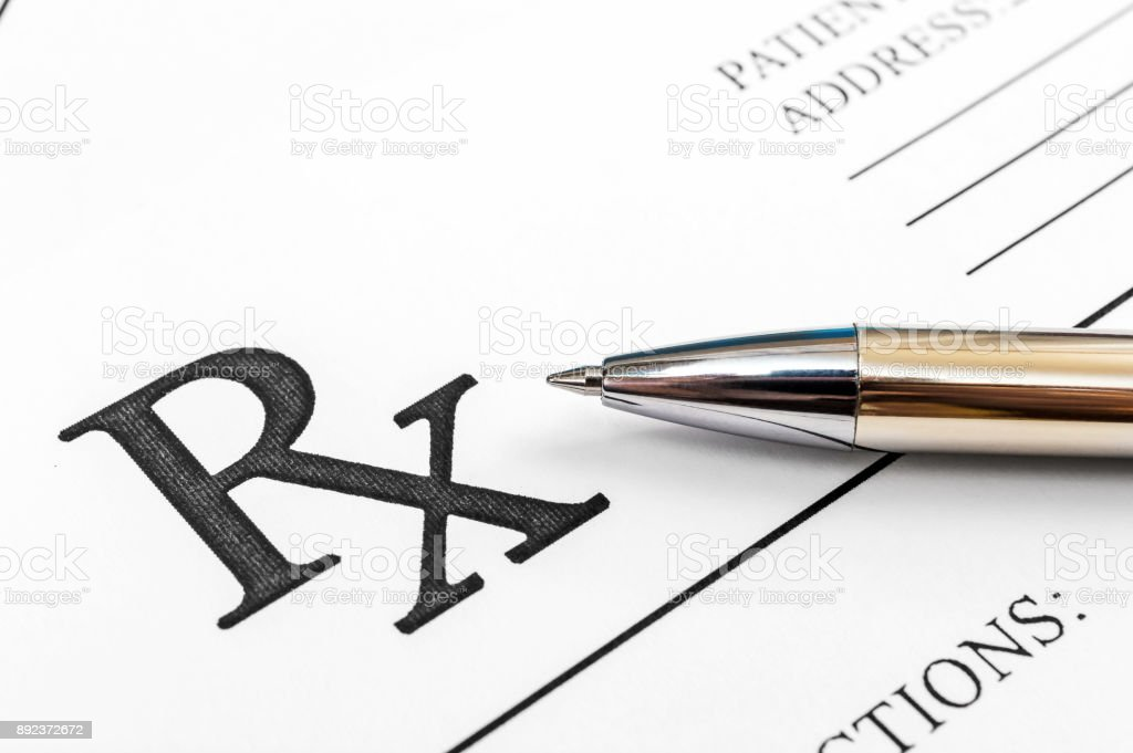 Pen on the prescription form. Close up.  Medical concept. stock photo