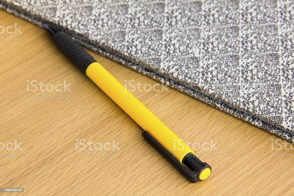 pen on the wooden desk stock photo