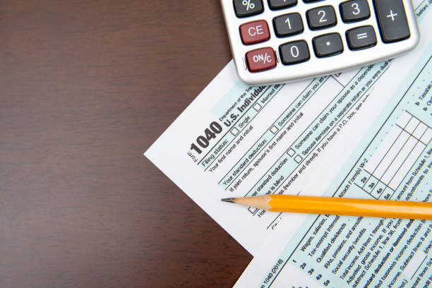 Pen on US TAX form Background. Tax Day concept stock photo