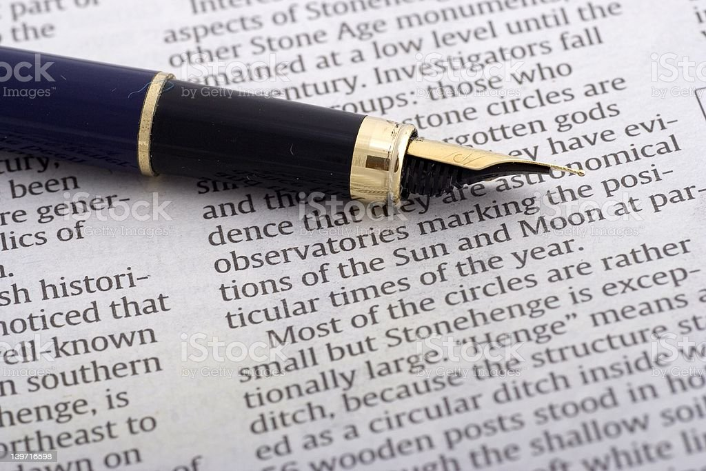 Pen Over Newspaper royalty-free stock photo