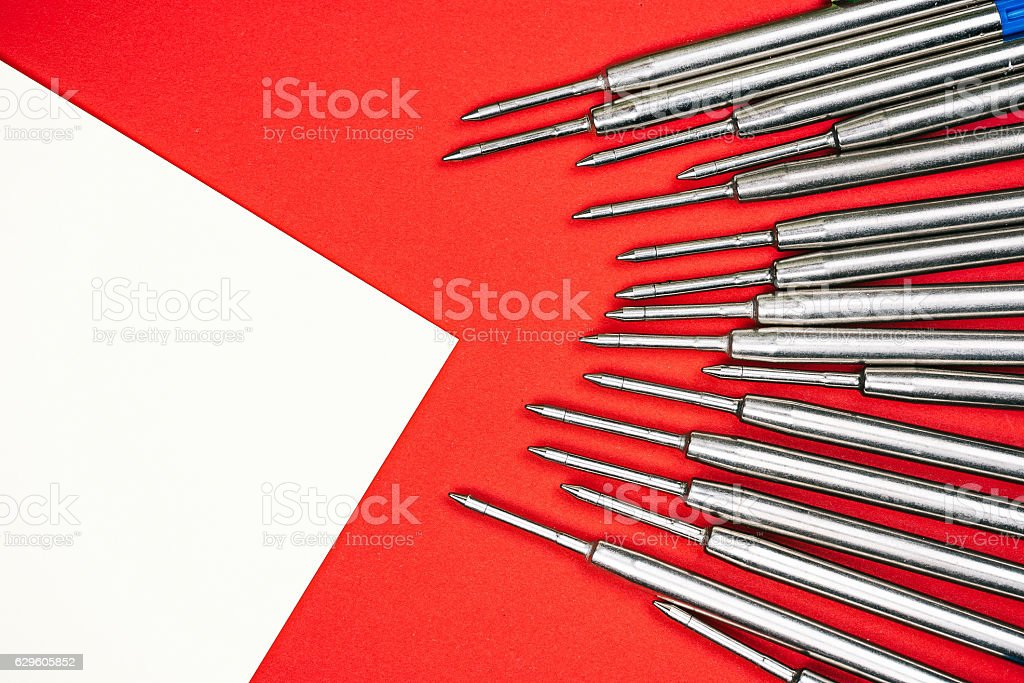 Pen refills and sticker over red stock photo