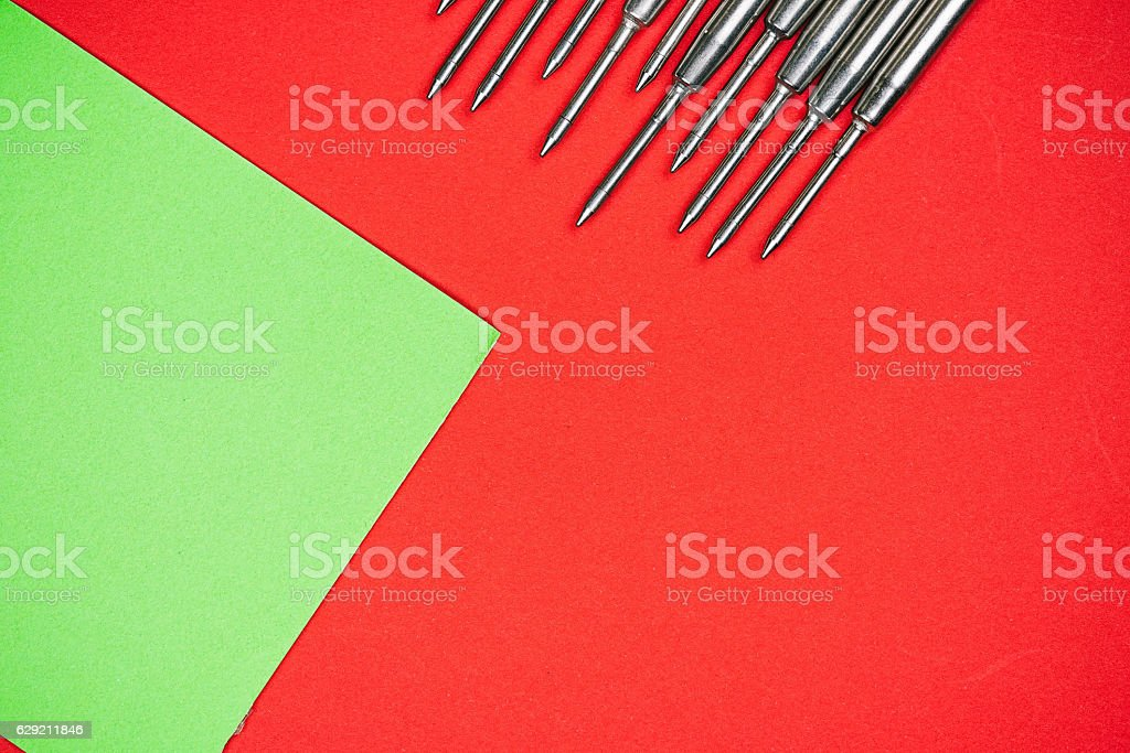 Pen refills on red and green paper stock photo