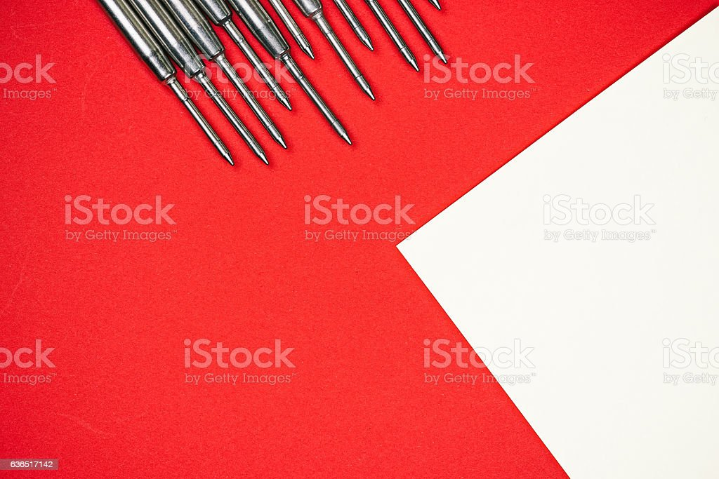 Pen refills on red and white stock photo