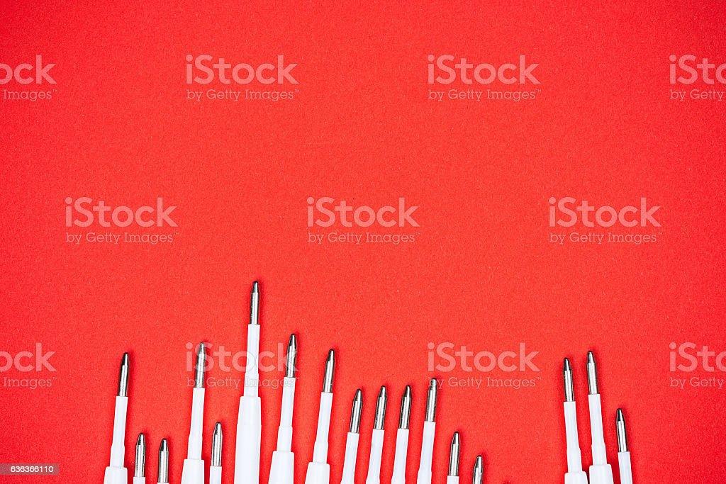 Pen refills on red stock photo