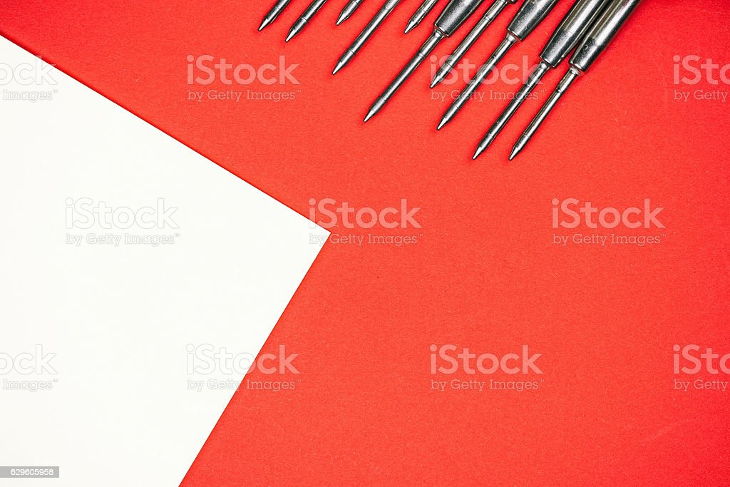 Pen refills over red and angle stock photo