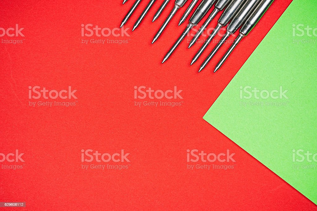 Pen refills over red and green stock photo