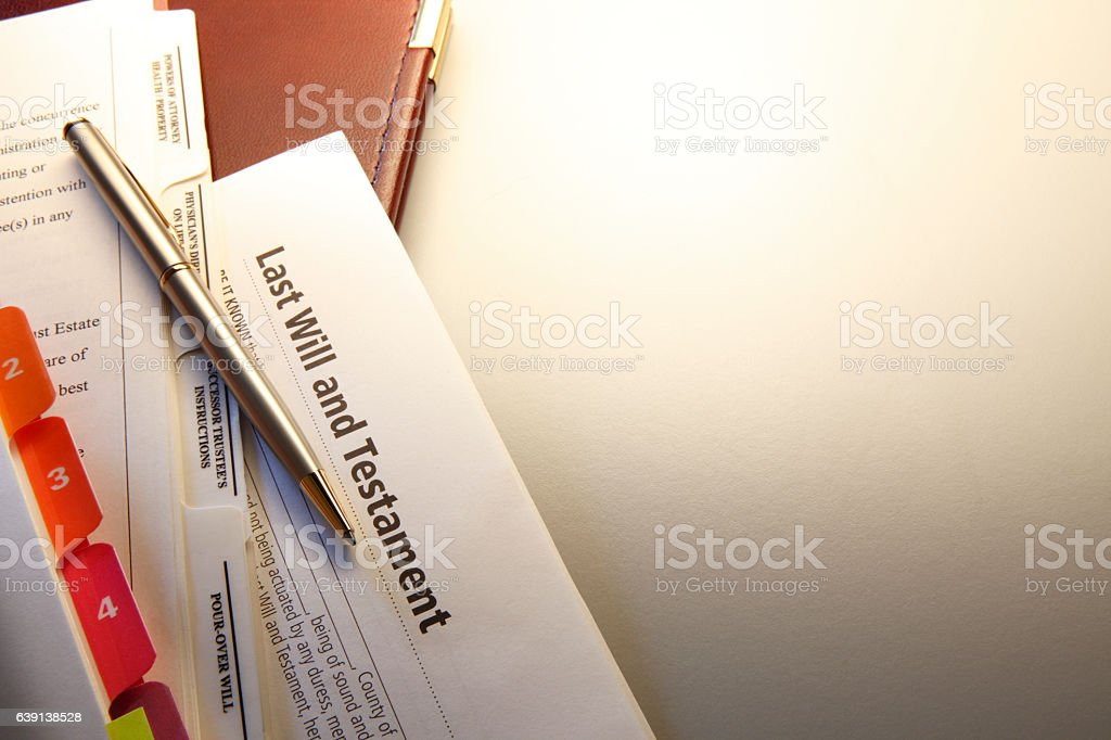 Pen Resting On Top Of Last Will And Testament stock photo