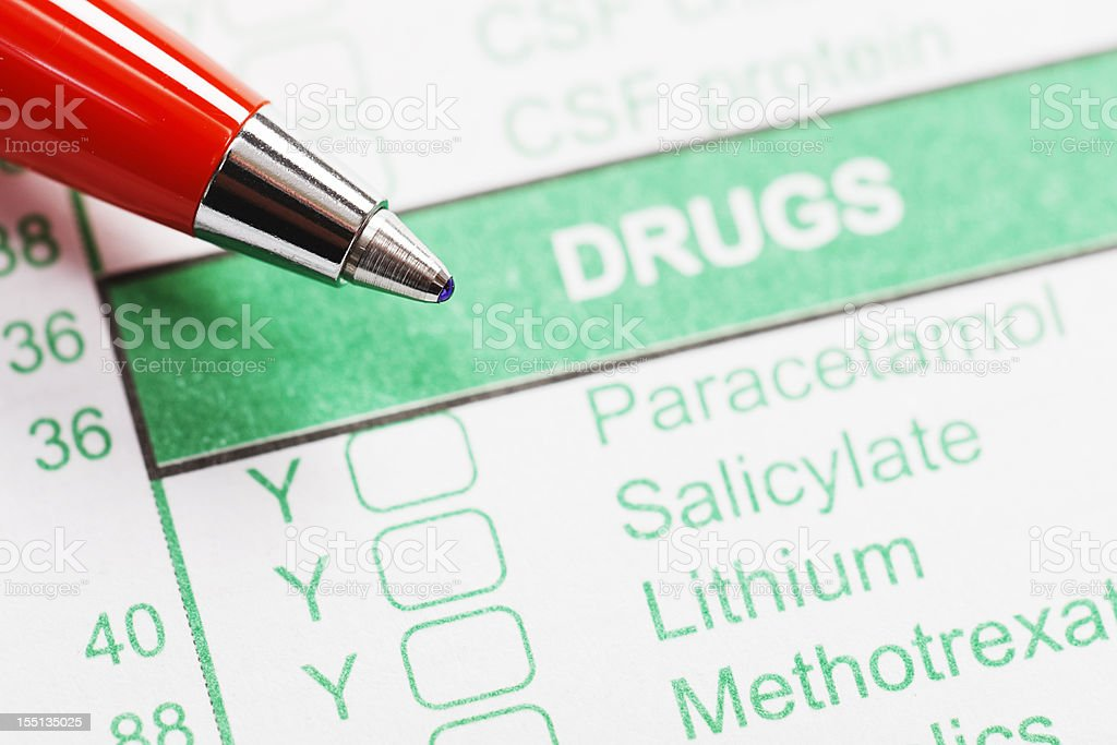 Pen rests on medical form ordering or recording drug use royalty-free stock photo