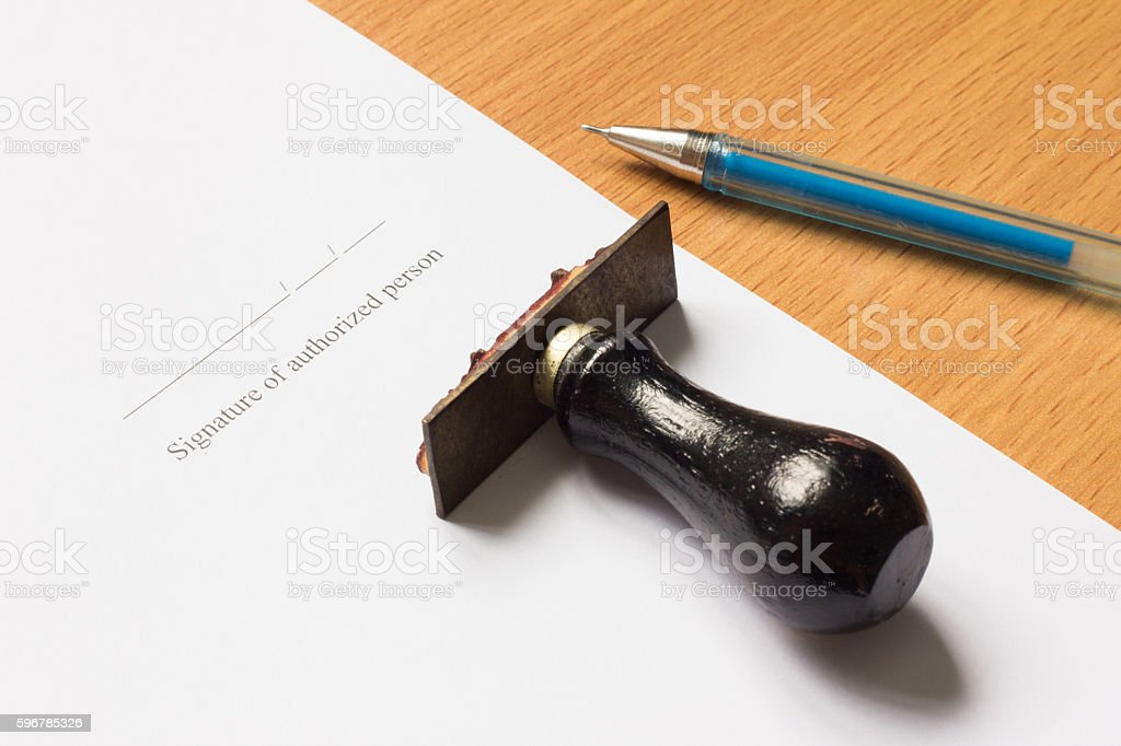 Pen, rubber stamp on paper with Signature stock photo