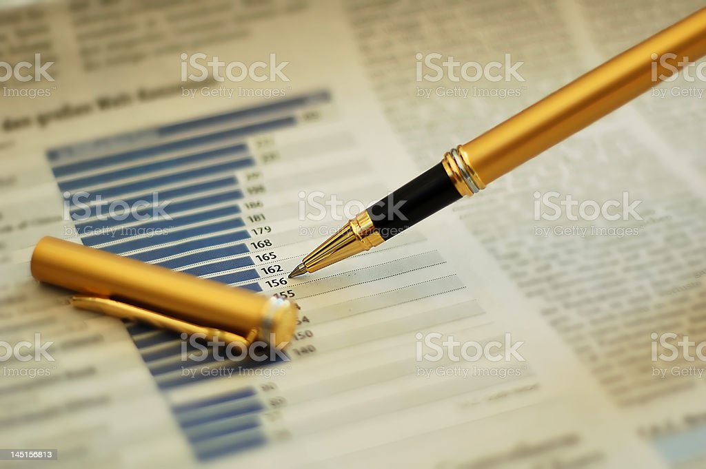 Pen showing diagram on financial report/magazine royalty-free stock photo