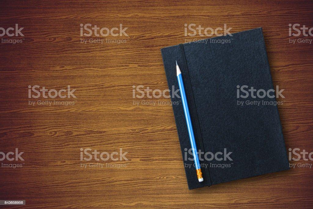 Kugelschreiber mit schwarzem Leder notebook – Foto