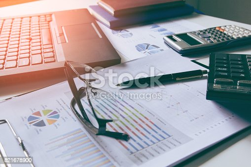 istock Pen with business graphs and charts report , calculator on desk of financial planing. Financial abstract . 821678900