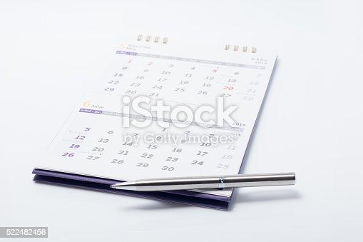 istock pen with calendar 522482456